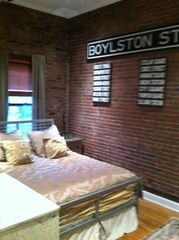 Boston condo photo - Bedroom Brick Exposed Wall with 1909 Boylston Street Original Subway Sign