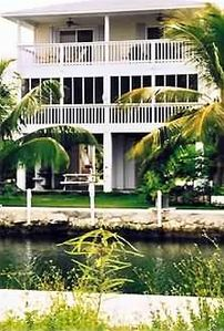 canal side porches overlooking the clear, swimming canal