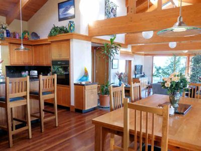 The dining & living areas have high-beam ceilings and Brazilian cherry floors.