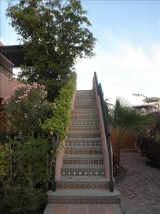 Tiled stairway to 2nd floor terrace, barbecue & lounge area, and master bedroom