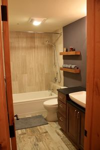 The remodeled second bathroom with tub