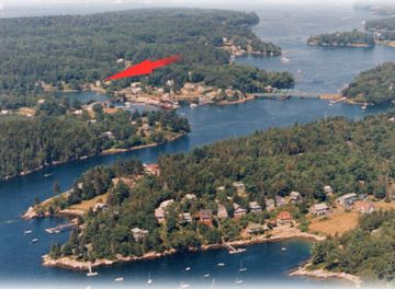 Coveside House location ( red arrow ) .