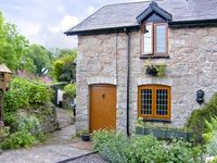 SMITHY COTTAGE, pet friendly, with open fire in Graigfechan, Ref 3556
