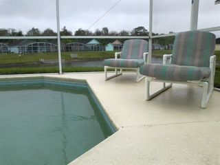 Town Centre Reserve house photo - Loungers by the pool for the perfect way to relax after the parks.