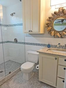 Stunning Bath, marble floors, glass tile, granite, wall faucets, European Charm.