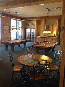 Lounge area includes pool tables and large screen TV