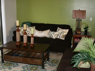 Princeville condo photo - Comfortable living room w/ 42 inch flat-screen, plenty of seating and ocean view