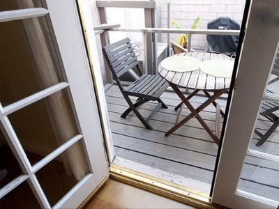 View of deck through the bedroom french doors.