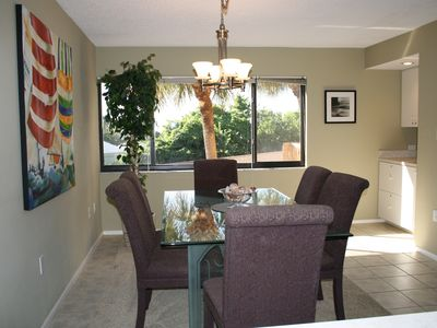Large dining room area with convenient wet bar.