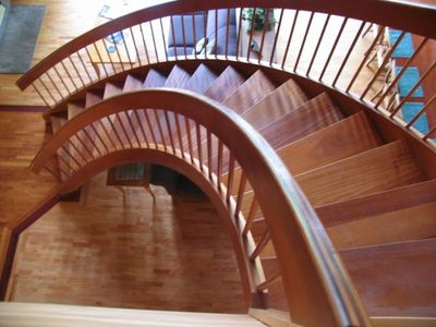Our beautiful mahogany radius stair is a central feature of the Great Room.