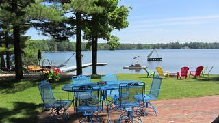 Interlochen cottage photo - Sit on the patio and enjoy the view of Bass Lake