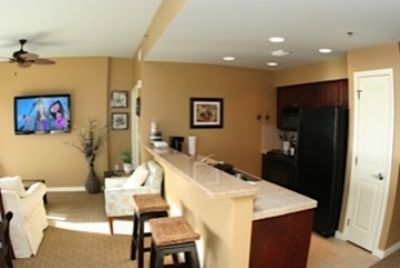 Fully equipped Kitchen and Breakfast bar boasts upgraded tile/granite surfaces.