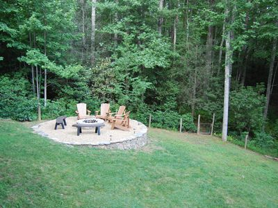 Fenced in back yard on large lot with fire pit and lots of privacy!