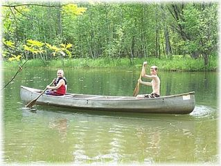 Gladwin house photo - Canoeing on the pond