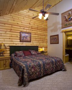 Branson cabin rental - The main level has two master bedrooms with baths, kitchen, screened porch & LR