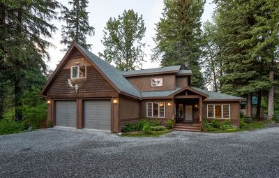 Enjoy your Alaskan Adventure in luxury at this private .6 acre estate