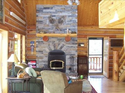 Woodburning fireplace in family room. French doors lead to deck. Stairs to loft.