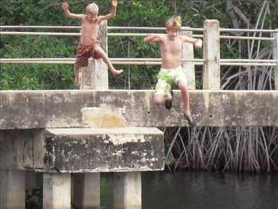 Jumping off the bridge at Sister Lou's - Black River