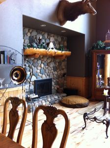Living room w/wood-burning fireplace.