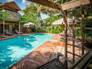 Key West house photo - The pool is surrounded by brickwork. There chaises, even a glider.
