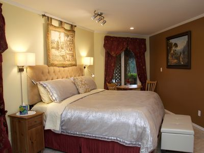 lovely Old World Charm themed master bedroom  with king size bed
