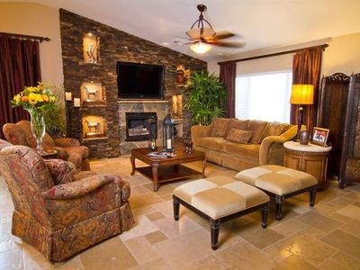 Living Room with Flat Screen Television over the Fireplace