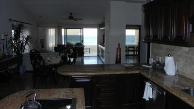 Living Area & Mstr Bdrm-Not the Best lighting but showing its ocean front Views!