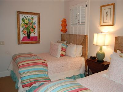 bright room with 2 double beds
