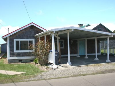 Pacific Beach cottage rental - The front of the cottage, showing ample uncover parking for two cars and bikes.