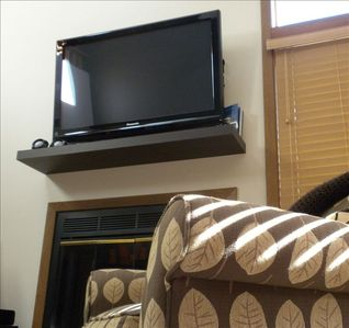 Galena townhome rental - 42 inch HDTV over the fireplace in the living room.