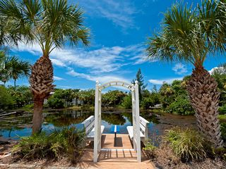 Sanibel Island house photo - Benches with table next to nature lake (in front of house and part of property)
