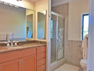 Poipu condo photo - Master bath with granite covered vanity and shower