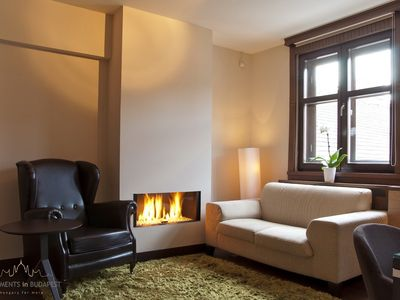 Andrassy 2 Apartment -Sitting room with fire place