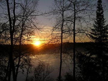 Mercer house rental - Sunrise as seen from the deck overlooking Wilson Lake