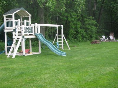 View of backyard with swingset and picnic area