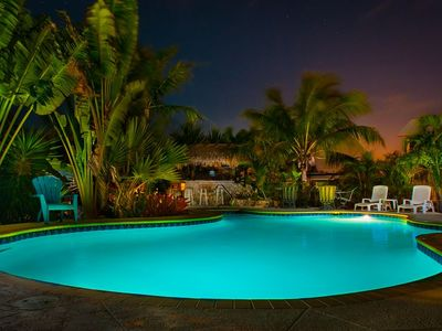 A gorgeous night to be sitting in or by the pool at Keyzee Tiki Vacation Rental