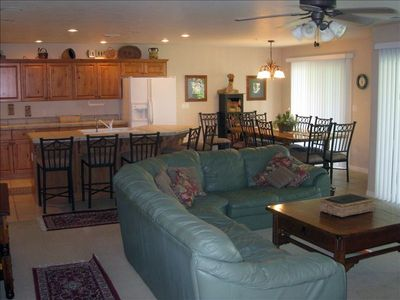 St. George condo rental - Living/Family Room with Kitchen & Dining table in background