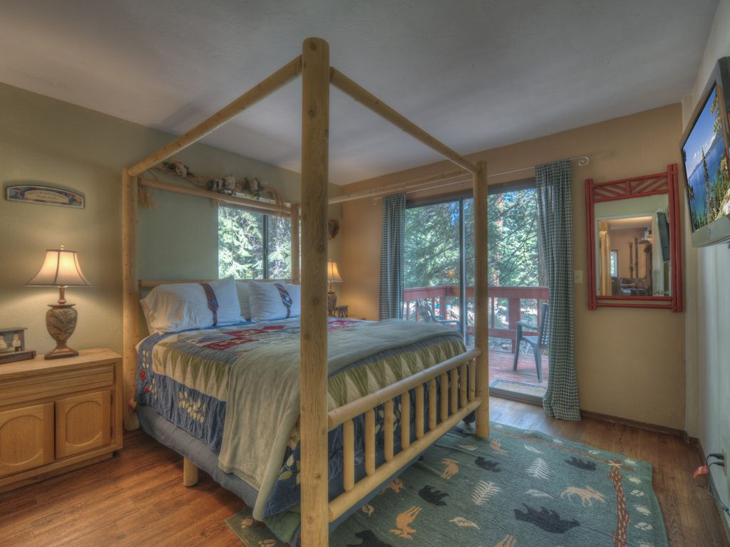 Queen bedroom with private deck on meadow