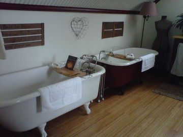 Alna cottage rental - Two clawfoot antique tubs in the Sheepscot River Suite.