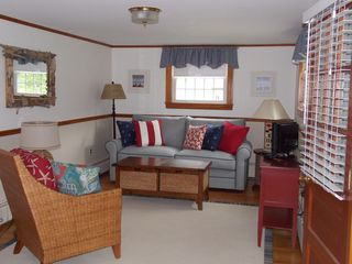 Rye house photo - Den with queen sleeper sofa and half bath