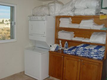 Separate utility room w/ full size washer/dryer, pool towels & extra linens