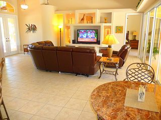 Cape Coral house photo - Great Room has 55' TV, stereo and all leather seating with 3 recliner lounges