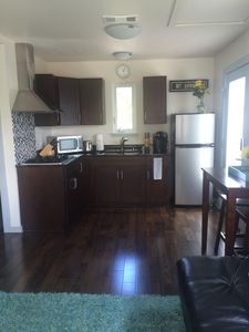 Solid wood floors, stainless appliances, granite countertops