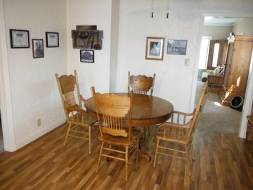 Table expands for 6. Interesting photos (incl. guests' fish!) & artifacts abound