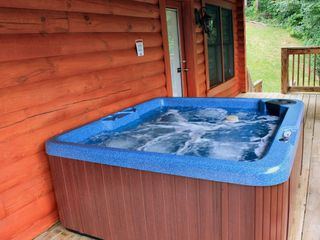 Gatlinburg cabin photo - New 5 person hot tub, deck leading to small yard.