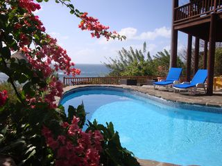 2012 stunning view of pool deck with new lower deck in background - Cap Estate villa vacation rental photo