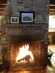 Rumney farmhouse photo - The living room has a lovely fireplace to enjoy during the cold months.