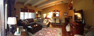 Great Room open to the dining area, bar and kitchen. Cozy fireplace, 50' TV