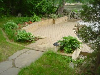 Newfound Lake house photo - Lakeside deck and beach area.