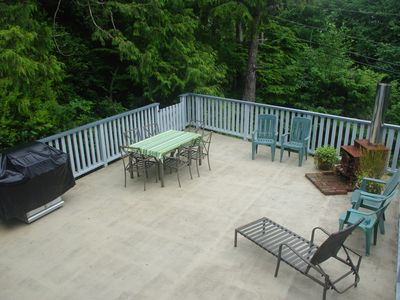 600 sq. ft. deck with outside wood-burning fireplace and barbeque